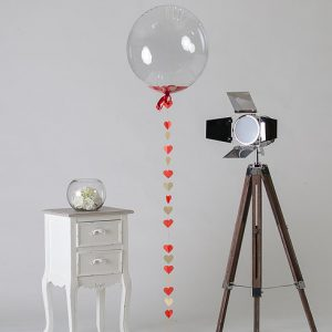 red heart confetti filled balloon
