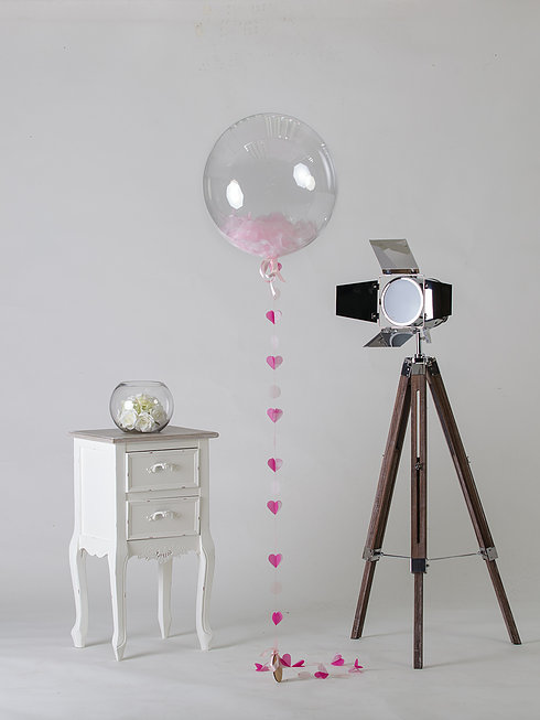 pale pink feather filled heart balloon