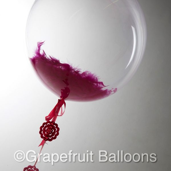Pink Feather Filled balloons
