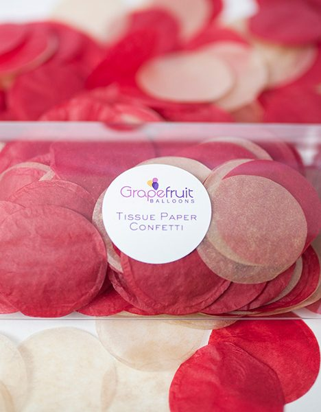 red and gold round tissue paper confetti